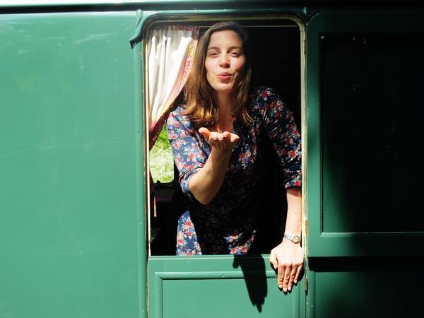 Woman in caravan window