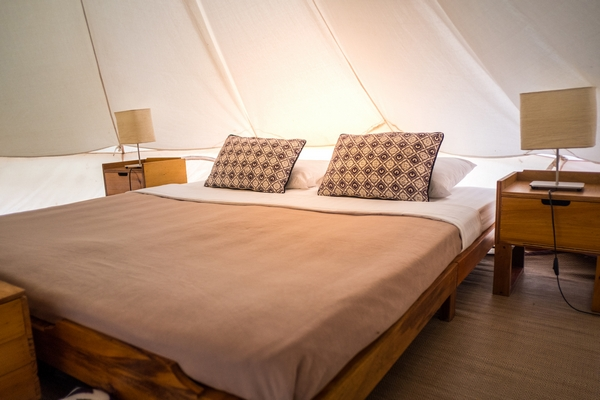 Bed in a tipi accommodation