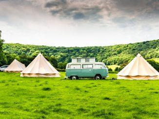 Campervan between 2 tipis
