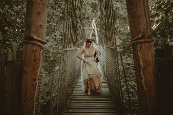 Bride on bridge at The Alnwick Garden
