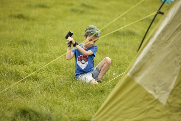 Child putting up tent at Deer Shed Festival