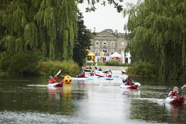 People canoeing down the river at Deer Shed Festival