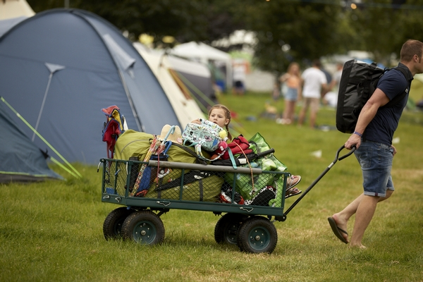 Someone pulling a wagon at Deer Shed Festival