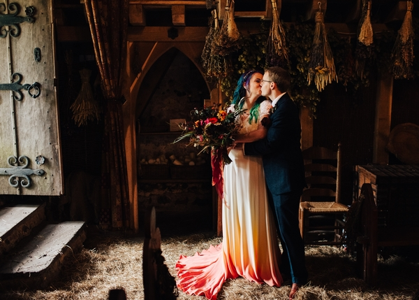 Married couple kissing at wedding in the village of Dode