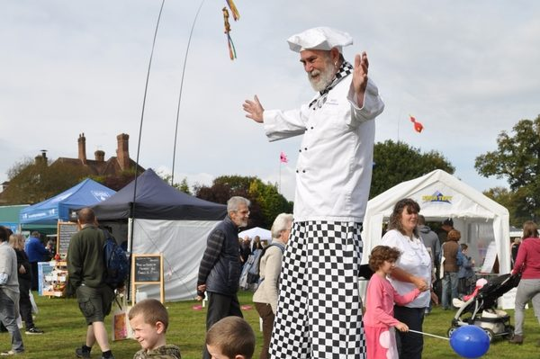 Man on stilts at The Forest Showcase