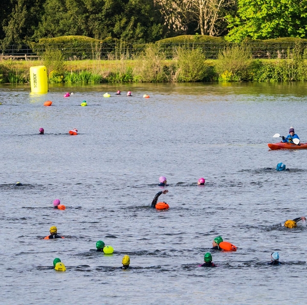 People swimming in open water