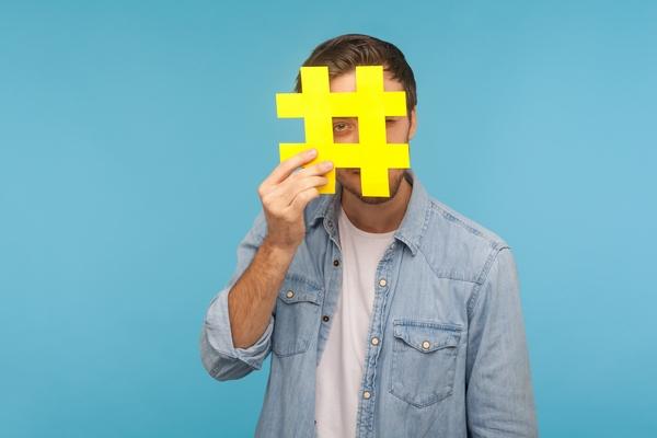 Man posing with hashtag symbol